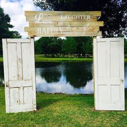 Vintage door arch with sign (in ground)
