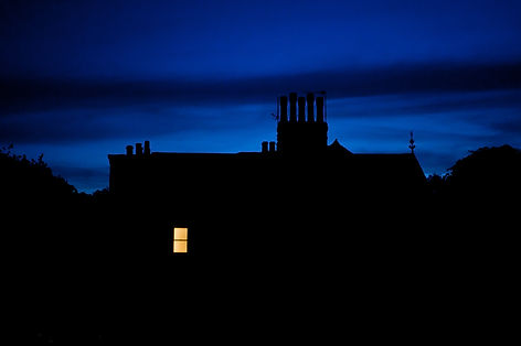Night scene of only one house window wit