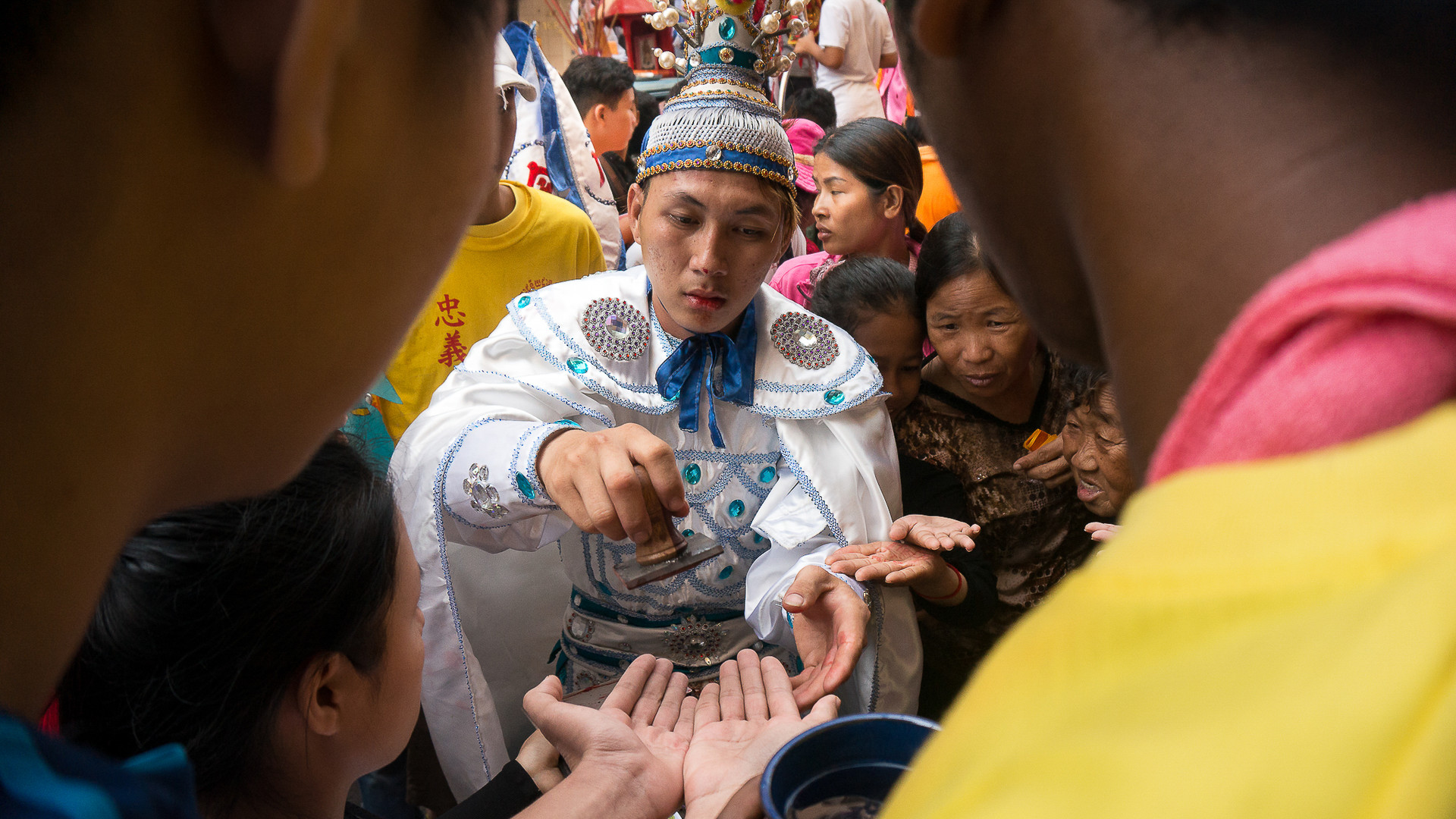 A spirit medium hands out blessings at Hai Neak Dta festival in Phnom Penh. These photos were published by United Catholics Asia News