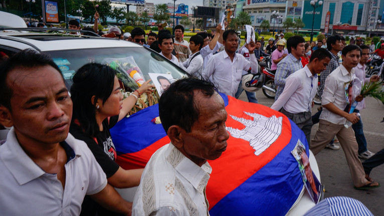 The body of slain activist Kem Ley being taken away amid mass mourning. I covered this story for Deutsche Presse-Agentur
