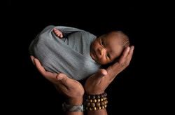 wrapped baby boy held by daddy