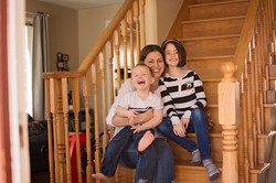 mom and kids sat on stairs