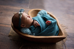 Wrapped baby girl in heart bowl