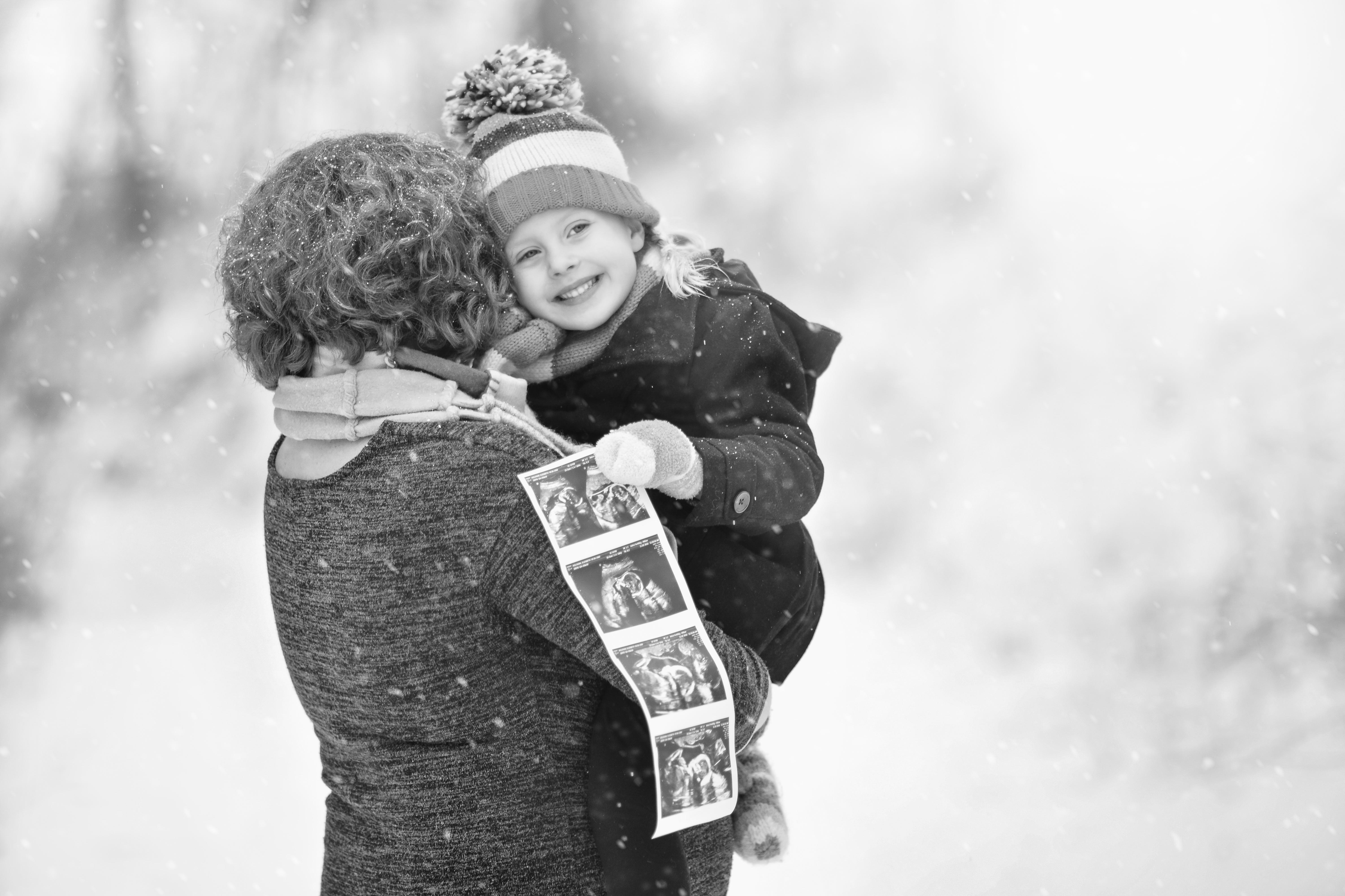 mom and daughter winter maternity