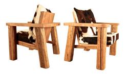 Fauteuil en vieux bois et peau de vache