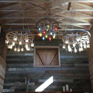 Handcrafted Chandeliers Above Stage Area