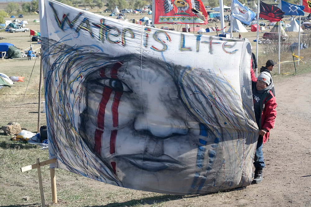Water is Life Banner at Oceti Sakowin Camp Entrance