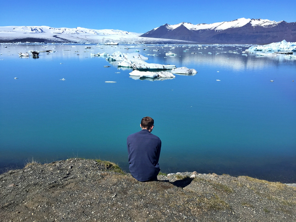 boy staring at glaciers in Iceland