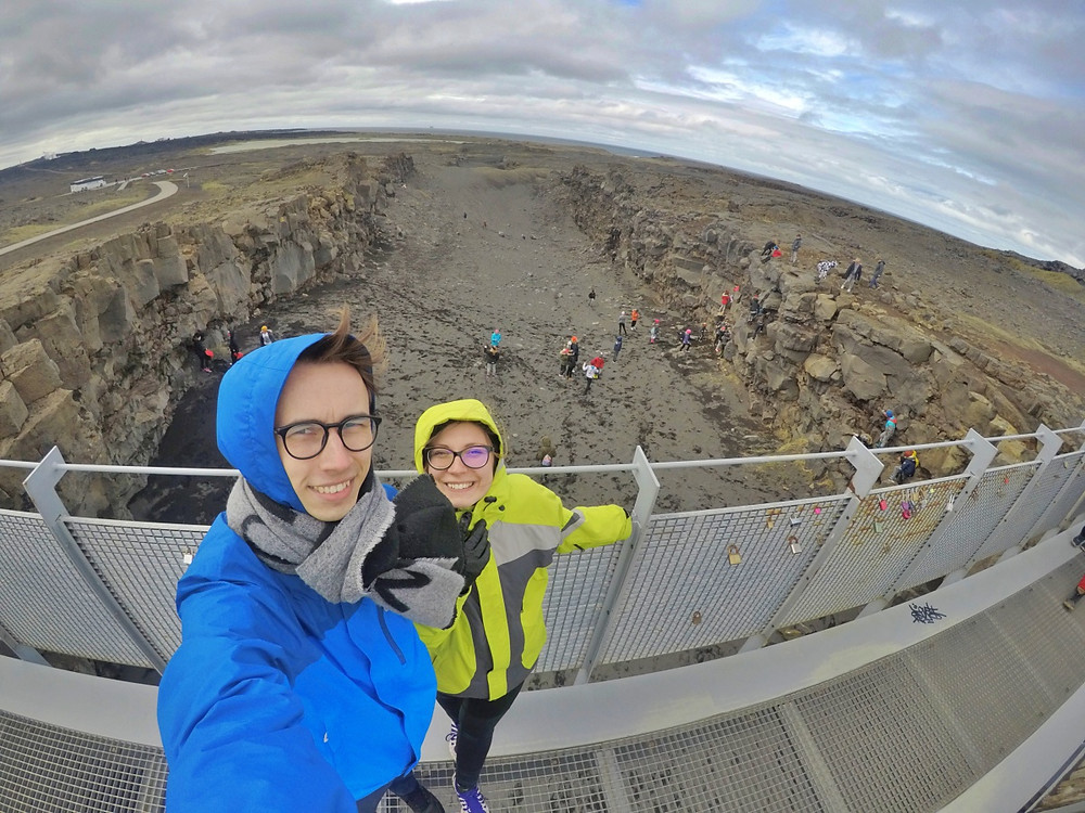 couple taking a selfie on bridge between two continents in iceland