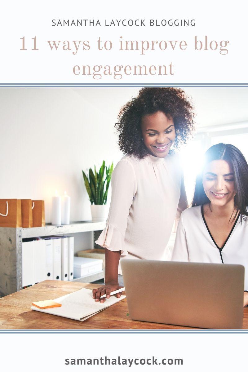 2 women talking near a computer.