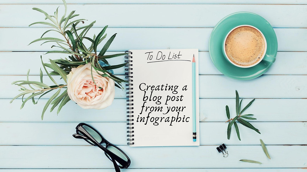 A blue wooden background with a beautiful flower, glasses, and a cup of coffee with a notebook on it that says to do list.