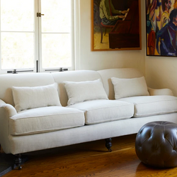 Custom Sofa with Piping Detail and Turned Front Legs on Casters