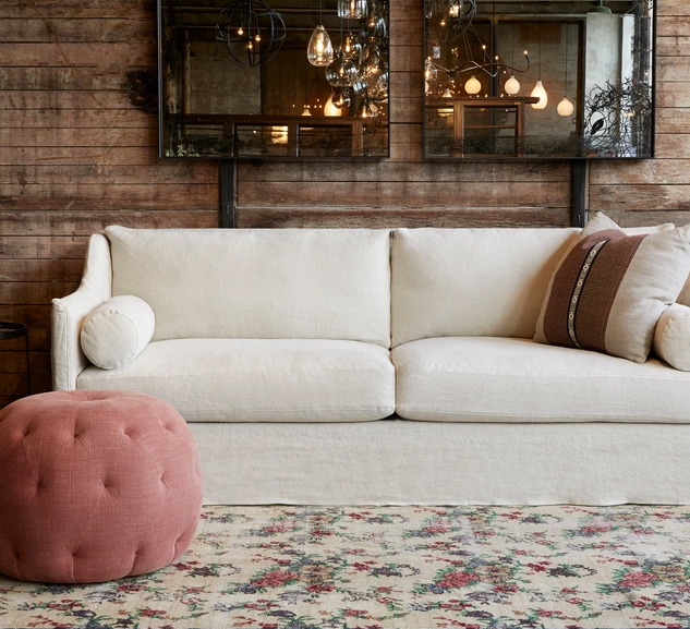 Curved Arm Rests and Bolster Pillows Offer Unique Comfort with This Sofa