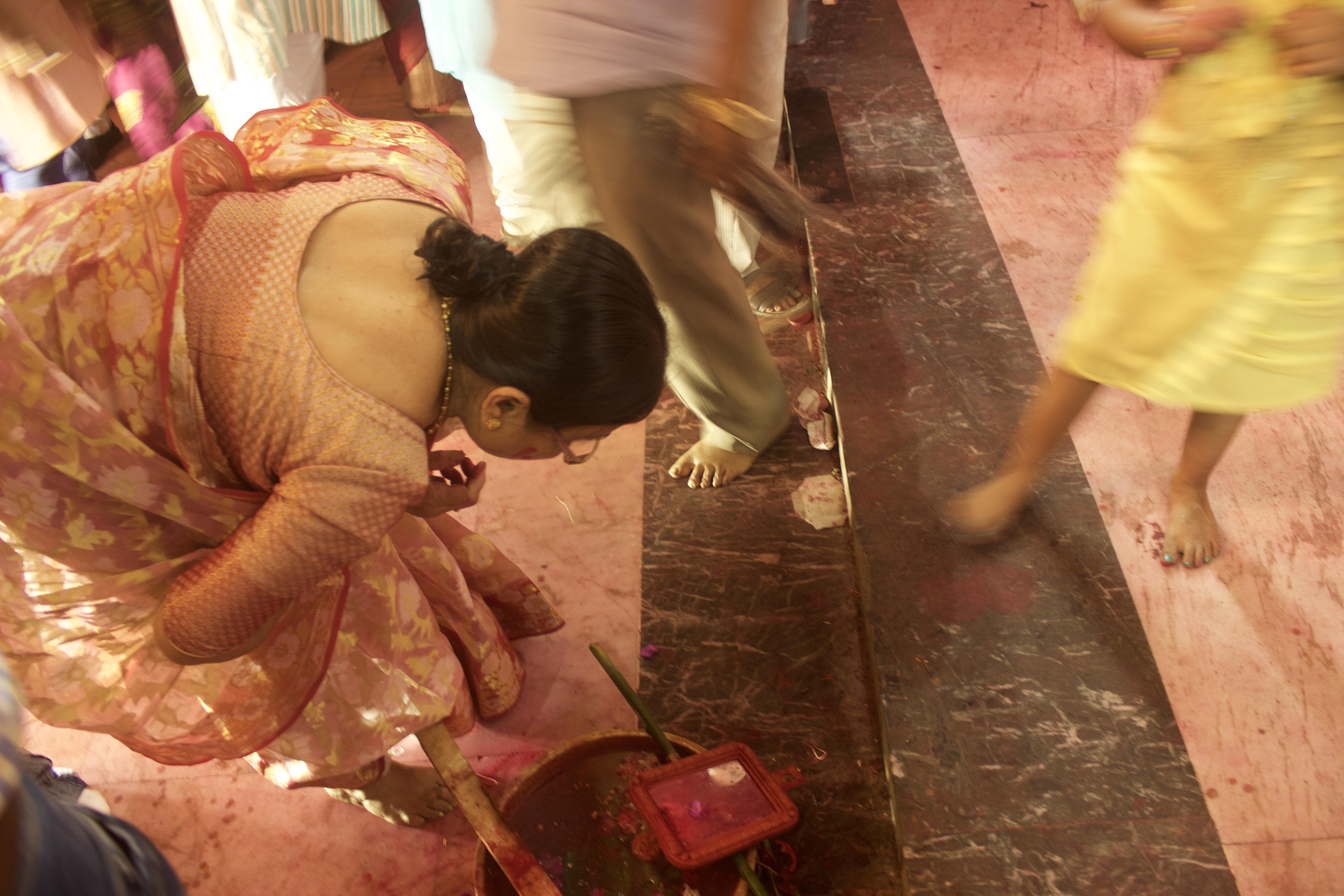 A women offering Prayer to Goddess