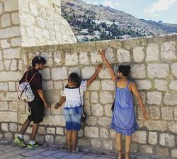 In between exploring walls of Dubrovnik - sometimes people start loving walls