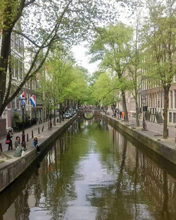 Beautiful Amsterdam - very rare to find such quiet canal on Kings Day