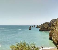 Welcome to Praia De Dona Ana beach . A beautiful writing day ahead. Have a beautiful day to everyone