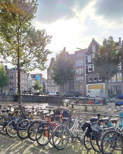 Touring canals of Amsterdam , sun just m