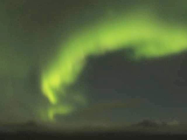 Snow covered mountains and Aurora dance