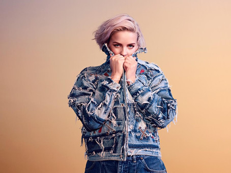 Anne-Marie visiting Rescue Rooms as part of headline tour
