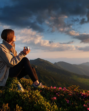 woman traveler drinks coffee with a view