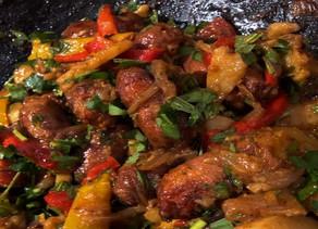 Finders Keepers: British food writer Diana Henry's  Salsiccia con patate e pomodori al forno