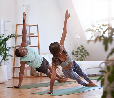 Young attractive couple practicing yoga