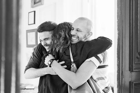Couple Hugging Friend_edited.jpg