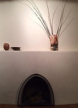 Luisa Baldinger's ceramic pieces on a mantle, Santa Fe, New Mexico