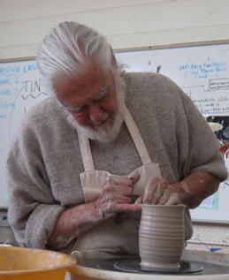Frank Willett throwing a pottery mug on the wheel, Santa Fe, New Mexico.