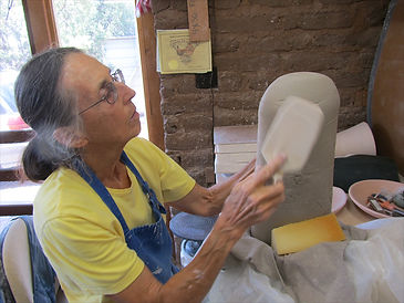 Luisa Baldinger demonstrates her technique for hand-building pottery vessels in Santa Fe, New Mexico
