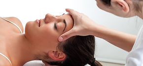 Woman has osteopathy for headache, head pain