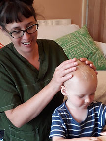 Child receives cranial osteopathy