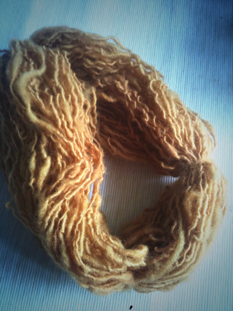 Hand spun yarn dyed with onion skins