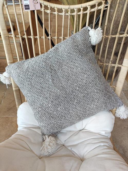 Coussin laine et gros ponpons