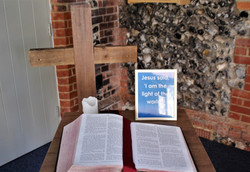 Bible and Candle in Doorway