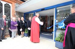 Bishop Adrian cuts ribbon