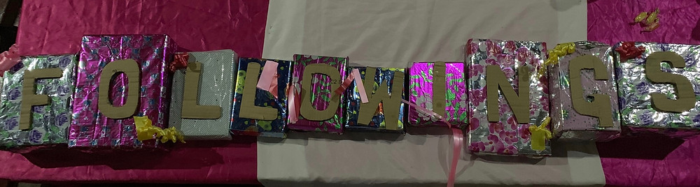 Small colourful boxes with the letters followings cut and and stuck on