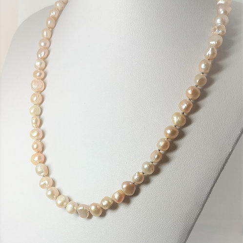 Hand knotted peach coloured pearls with a Sterling Silver 'S' clasp
