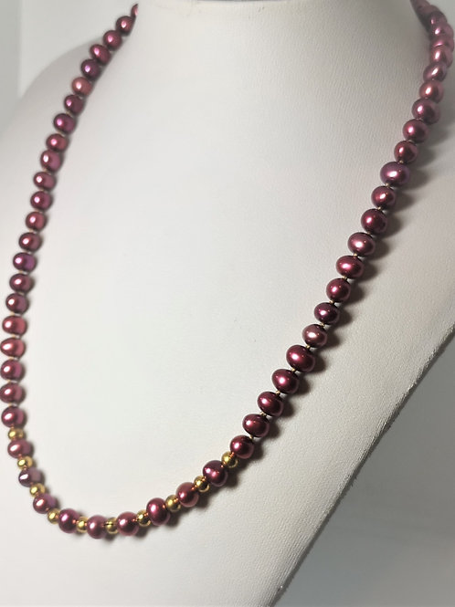 Hand knotted cherry pearls with gold plated Sterling Silver