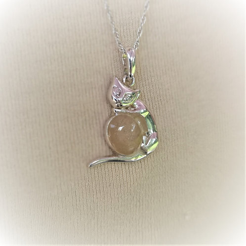 Sterling Silver cat holding an oval set with resin