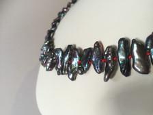 Biwa style pearls on red Silk