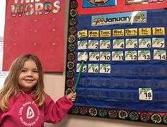 Preschool Girl and Calendar
