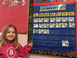 Preschool Girl and Calendar