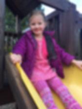 Pre-K Girl on Playground Slide