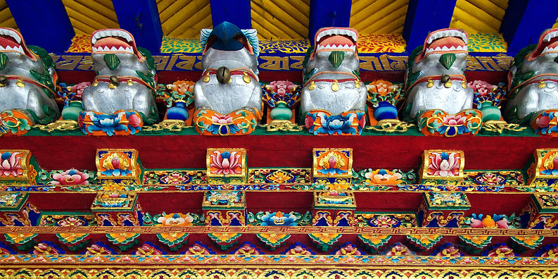 Carving above doorway to the entrance to the Norbulinka, summer palace of the Dalai Lama, Lhasa, Tibet