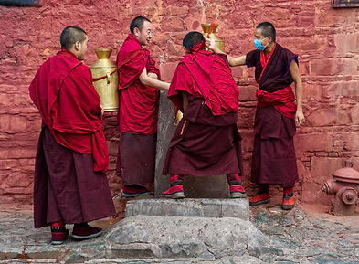 Monks collecting water at Tashilhunpo Monastery, Shigatse, Tibet