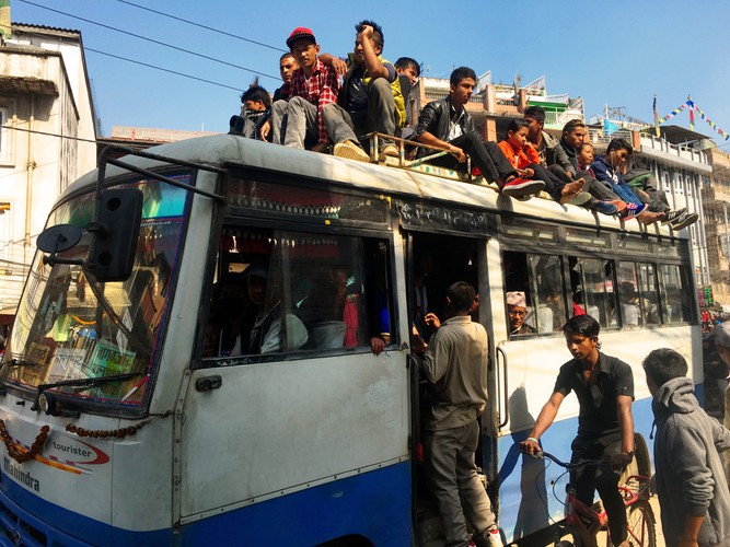 crowd ontop bus.jpg