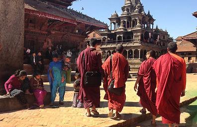 Monks walking through Patan Square, Kathmandu, Nepal
