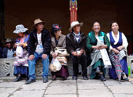 Pilgrims enjoying the festivities at the Norbulinka, summer palace of the Dalai Lama, Lhasa, Tibet